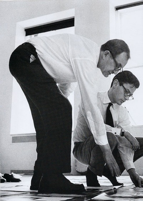 This is an image of Alexey Brodovitch (on left) and Richard Avedon (on right) working together looking at images.